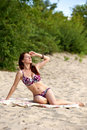 Young woman sunbathing Stock Photo