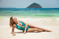Young woman sunbathing at tropical beach beautiful Stock Photos