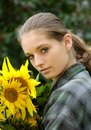 Young woman with sunflower Royalty Free Stock Photos