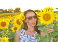 Young woman in sunflower field Royalty Free Stock Photo