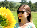 Young woman in sunglasses on the nature, sunflower reflected in glasses Royalty Free Stock Photo