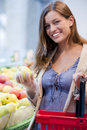Young woman at supermarket Stock Photography