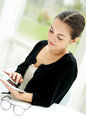 Young woman surfing on a tablet-pc Royalty Free Stock Photo