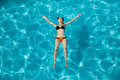 Young woman in swimming pool redhead Royalty Free Stock Image
