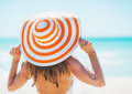 Young woman in swimsuit beach hat looking into distance Royalty Free Stock Photo