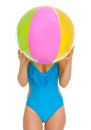 Young woman in swimsuit hiding behind beach ball Royalty Free Stock Photo