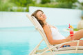 Young woman in swimsuit relaxing with cocktail Stock Photos