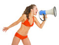 Young woman in swimsuit shouting through megaphone isolated on white Stock Photos