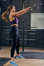 Image : Young Woman Swinging Kettlebell in CrossFit Gym in in windmill