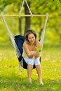 Young woman swinging outdoor Stock Photo