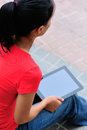 Young woman with tablet asian in hands Royalty Free Stock Photography