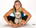 Young woman taking a break from exercising with pet dog on white background Royalty Free Stock Photography