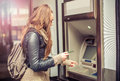 Young woman taking money from ATM Royalty Free Stock Photo