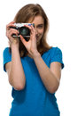Young woman taking a photograph with compact camera concentrating as she composes and focuses the image isolated on white Stock Photo