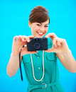 Young woman taking photograph with copyspace Stock Images