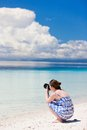Young woman taking photos at beach Royalty Free Stock Photography