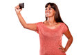 Young woman taking a picture with her mobile Royalty Free Stock Image