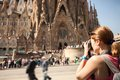 Young woman taking picture of Sagrada Familia, Barcelona, Spain Royalty Free Stock Photo