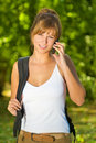 Young woman talking on cell phone and enjoying her day in nature Stock Photos