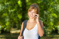 Young woman talking on cell phone and enjoying her day in nature Royalty Free Stock Images
