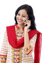 Young woman talking on mobile phone against white Royalty Free Stock Photo