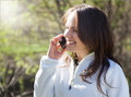 Young woman talking on mobile phone and smiling beautiful Royalty Free Stock Photo