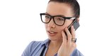 Young woman talking on mobile phone wearing glasses looking away Stock Photo