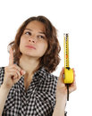 Young woman with a tape measure