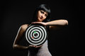 Young woman with a target in the dark Stock Images