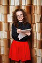 Young woman teacher checks music book. Royalty Free Stock Photo