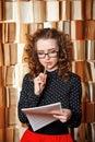 Young woman teacher checks music book. Royalty Free Stock Photo