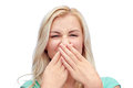 Young woman or teenage girl closing her nose Royalty Free Stock Photo