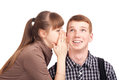 Young woman telling a secret to a man Stock Images