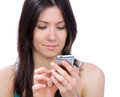Young woman texting on mobile cell phone mobile Royalty Free Stock Photography