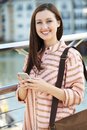 Young Woman Texting On Mobile Phone Walking To Work Royalty Free Stock Photo