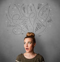 Young woman thinking with arrows over her head Royalty Free Stock Photo