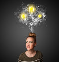 Young woman thinking with arrows overhead pretty smoke and lightbulbs above her head Stock Image
