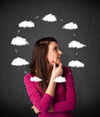 Young woman thinking with cloud circulation around her head thoughtful drawn clouds circulating Stock Photo