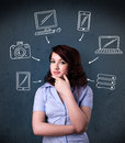 Young woman thinking with drawn gadgets around her head thoughtful multimedia icons Stock Photo
