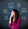 Young woman thinking with drawn gadgets around her head thoughtful multimedia icons Royalty Free Stock Photography