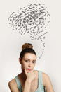Young woman with thoughts clouds above her head portrait of confusing Royalty Free Stock Photo