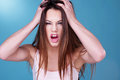 Young woman throwing a temper tantrum Royalty Free Stock Photo
