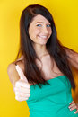 Young woman with thumb up Royalty Free Stock Photography
