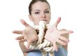 Young woman with tied up hands Stock Photo