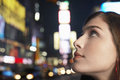 Young woman in times square new york at night closeup of a smiling looking up Stock Image