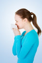 Young woman with tissue sneezing allergy or cold Stock Photography