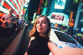 Young woman tourist laughing and taking selfie photo in New York City, Manhattan, Times Square Royalty Free Stock Photo