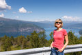 Young woman tourist in norway fjord Royalty Free Stock Photography