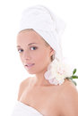 Young woman with towel on head and flower beautiful isolated over white background Stock Images