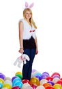 Young woman with a toy rabbit Royalty Free Stock Image